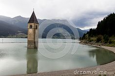 The particolar bell tower partially submerged in the alpine lake of Resia in Val Venosta