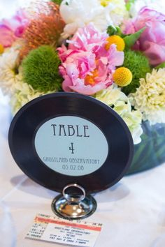 table number record and concert ticket menu....LOVE the idea of this!! Not ACL but def me lol
