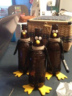 Penguins out of root beer bottles