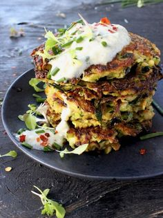 These zucchini patties look just like many of their less healthy counterparts, but using zucchini as the base gives them a healthier twist. Serve as an appetizer or pack them up for packed lunches. | Ciao Florentina recipe for Zucchini Patties with Tzatziki Sauce