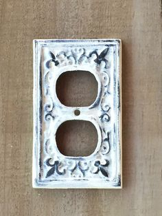 Distressed Painted Cast Iron Outlet Cover by TrueNorthHome on Etsy https://www.etsy.com/listing/490971005/distressed-painted-cast-iron-outlet
