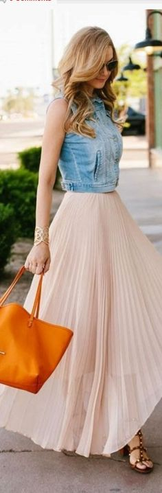 Love the sophisticated long full skirt paired with the casual crop denim vest