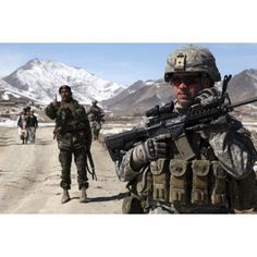 US Army soldier conducts a patrol with a platoon of Afghan National Army soldiers Canvas Art - Stocktrek Images (35 x 23)