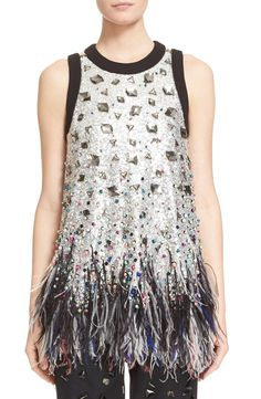 Captivating the crowd in this glitzy, glam tunic.