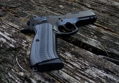 This Black/Gray Alien grip is bound to make your even more fun to own and operate. Shooting Guns, Shooting Range, Cz 75 Grips, Firearms, Shotguns, Grey Alien, You Magazine, 2nd Amendment, Guns And Ammo