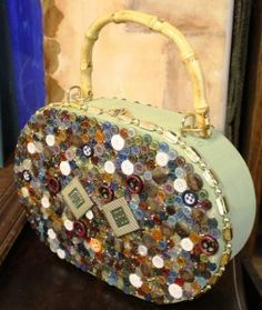 Great idea to cover a vintage purse with a variety of vintage buttons.
