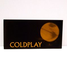 Coldplay+Sticker+Black+and+Gold+Band+Sticker+with+by+MohawkMusic