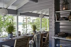 decordemon: A beautiful lake cottage by Krista Keltanen photography Lake Cottage, Cottage Homes, French Apartment, Dutch House, Wooden Ceilings, Famous Architects, Marble Fireplaces, Outdoor Settings, Table Settings