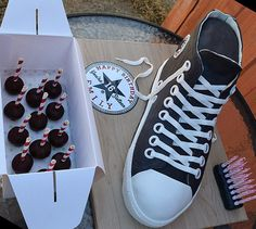 """3D Converse High Top Shoe Cake, with """"Happy 16th Birthday"""" incorporated into the Converse logo.   Plus some cake pops to match.  Inside:  Chocolate cake with whipped dark chocolate ganache buttercream."""