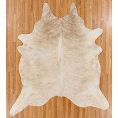 I DIE OVER THIS. Amazing cowhide rug. Absolutely gorgeous, and from World Market?!