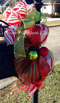 Christmas mailbox swag with bow and ornaments