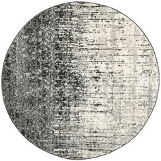 The durable cotton canvas backing and abstract print of this contemporary round grey rug provide an eye-pleasing addition to any decor. Versatile and stylish, this rug is tough enough to stand up to even the busiest rooms in your home or office.