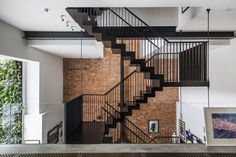 Entering the apartment from the street level, guests meet a dramatic, three-story atrium and a feature staircase. A glass balustrade heightens the effect.