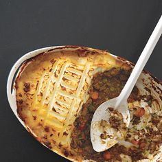 Shepherd's Pie--  1 tablespoon vegetable oil  1 large onion, peeled and chopped  1 large carrot, peeled and chopped  1 pound ground lamb (or substitute half with another ground meat)  1 cup beef or chicken broth  1 tablespoon tomato paste  1 teaspoon chopped fresh or dry rosemary  1 tablespoon chopped Italian parsley  1 cup frozen peas  2 pounds russet potatoes, peeled and cut into chunks  6 tablespoons unsalted butter  1/2 cup milk (any fat content)  Kosher salt to taste