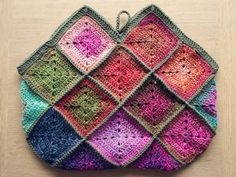 my Noro bag is nearing completion.
