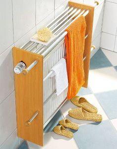 Per avere asciugamani sempre asciutti e caldi, li possiamo accostare al corpo radiante del termosifone progetto fai da te: stenditoio copritermosifone