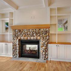 indoor/outdoor fireplace using beach stones!