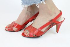 Gorgeous 1970s Gucci heels! Done in bold red leather. Super strappy look with snake-skin detailing. Leather soles.  ♥♥♥ Brand: Gucci Size on tag: 38 Fits like: 8 US / 38 EU / 6 UK Color: Red Material: Leather, Suede Condition: Excellent Vintage  *foot model is a size US 6  ✂-----Measurements Length Heel to Toe Inside: 9.5 Width Widest Part Outside: 3 Heel Height: 3   m i n t : pristine with no signs of wear- possibly deadstock  e x c e l l e n t : signs of normal wear and age- no obvious…