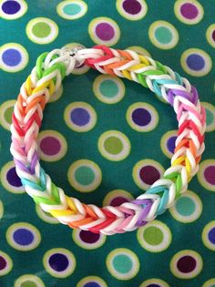 Rainbow and white rainbow loom rubber band bracelet -- I like the way the colors break up with the white