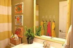 When girls and boys share spaces, it's hard to make everyone happy, but this shared bathroom has some great ideas on how to create a gender-neutral space for all. A sage wall color and yellow accents — we spy a West Elm Stripe Shower Curtain ($31, originally $39) — keep things neutral and modern. Canvases done by the kids — in colors that mommy chose to match the color scheme — provide art for the bathroom, while numbered hooks make a fun place to hang towels.  Source: Emily A. Clark