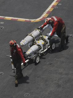 GULF OF OMAN (June 15, 2013) – Sailors transport ordnance across the flight deck of the aircraft carrier USS Nimitz (CVN 68). Nimitz Strike Group is deployed to the U.S. 5th Fleet area of responsibility conducting maritime security operations, theater security cooperation efforts and support missions for Operation Enduring Freedom. (U.S. Navy photo by Mass Communication Specialist Seaman Apprentice Kelly M. Agee/ Released)