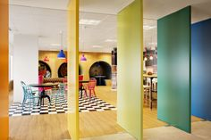 Sony Music - Madrid Office / Rotating Wall Panels / Color / Mixed Flooring / Colorful Pendants