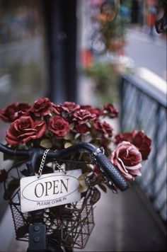 The sign outside our flower shop.  If the shop is not open when you want to go, we'll send someone over to open it for you.