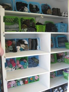 simple family laundry closet... using dollar store baskets and bins.... great organizing idea for everyone's room and for the hall closet#BASKETS ON SIDES#LAUNDRY RM#CLOSET