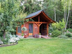 Too cute to be a garden shed - looks like a garden cottage
