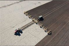 Case IH steiger pulling a massive seed drill birds eye view.