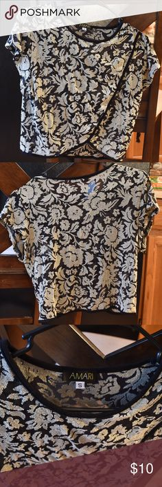 Sale‼️ Floral Crop Top Sheer black and light gold floral crop top with a slight v-cut shape at the bottom.  This top pairs well with black high waisted shorts or pants for a springtime edgy look. I usually wear this top with my American Apparel black disco pants and high heeled boots.   Size: Small Used Amari Tops Crop Tops