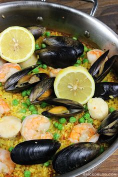 This Classic Spanish Seafood Paella recipe features a variety of seafood, including shrimp, mussels, and scallops.