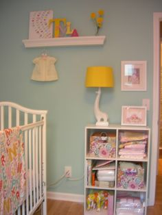 blue room for girls! super cute ideas wall color...white cubes with brown baskets