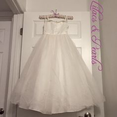 Lilacs & Pearls Formal Communion Girls 7 Lilacs & Pearls Formal Communion Girls 7   Size: Children's 7  Color: White   This a beautiful dress with lots of layering, petticoats, & lining.   100% Polyester   There are a few seed beads missing but it's not noticeable unless you are looking for it & you can't tell from a distance. However, it is an easy & cheap fix. It has decorative buttons in the back along with a hidden zipper. This was a very expensive dress   ❌No Trades ❌If sold elsewhere…