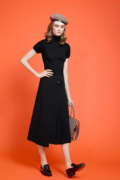 Paule Ka - Pre-Fall 2015: it has a WWII French resistance ring to it but it is here because of the skirt -- pretty in pleats