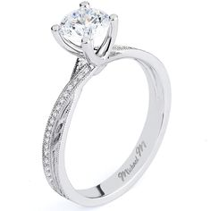 Delicate strands of unique U-set pave diamonds intertwine around the band to support this stunning solitaire Michael M Engagement Ring.