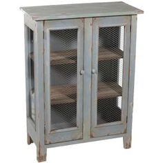 """Distressed wire mesh-front cabinet with three interior shelves.   Product: CabinetConstruction Material: Wood, glass, and metalColor: Distressed blueDimensions: 42"""" H x 31.5"""" W x 15"""" D"""