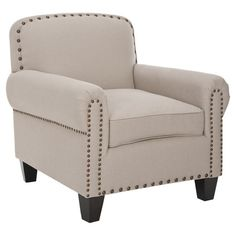 Arm chair with antiqued nailhead accents.Product: ChairConstruction Material: Birch wood, plywood and fabric upholster...