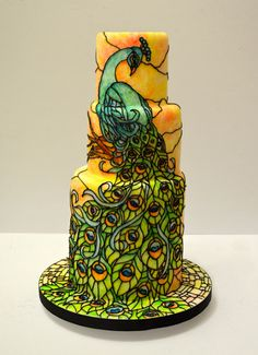 stained glass peacock wedding cake