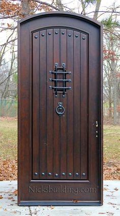 rustic arched exterior single doors knotty alder medium distressed left hand or right hand swing