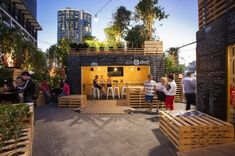 More pallet design DIY ideas and inspiration at http://pinterest.com/wineinajug/passion-for-pallets/ The centerpiece of this year's Melbourne Food & Wine Festival is the Urban Coffee Farm and Brew Bar by HASSELL. Built from shipping pallets and shipping containers, the open air cafe is filled with plants to create a coffee farm right in the heart of the city