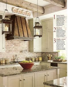 Possibly the perfect rustic kitchen! From the soft brick color to the ceiling beams and lanterns...perfection :-)