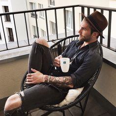 Men's hat, fedora, coffee, holey jeans