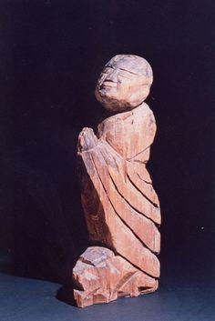 Buddha sculpture by the Japanese monk Enku (1632-1695) in namaskara or anjali mudra, gesture of praying.