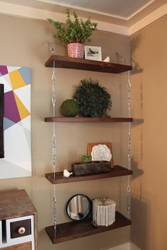 Suspended wall shelves using turnbuckles.