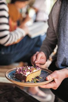 Recipe: Black Star Pastry's orange cake with cream cheese and figs: Chris Thé, owner of Sydney's cult Newtown bakery Black Star Pastry shares the recipe for his orange cake with cream cheese frosting, Iranian figs and pistachios, in the new Broadsheet Sydney cookbook.