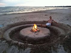 How sweet is this fire pit on the beach idea? And a guy to dig it for me? Perfect. ;)