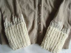 Pretty way to lengthen sleeves on a cardigan? With knitting and embroidery