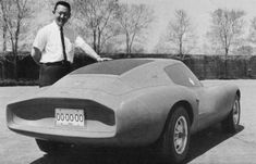 Larry Shinoda with the early Monza GT clay on the design staff review patio.