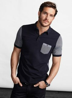 Contrasting pocket and sleeves